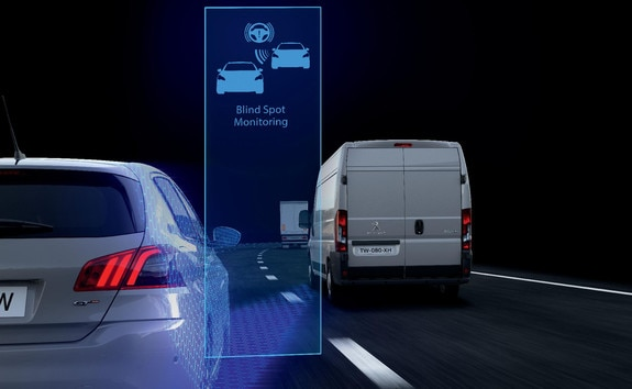 The Blind-Spot Monitoring* inform the driver of the presence of another vehicle in the blind spots of his or her PEUGEOT Boxer, if this presents a potential danger